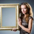 Young woman with picture frame on white — Stock Photo #13169398