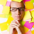 Woman with lots of reminder notes — Stock Photo #13169410