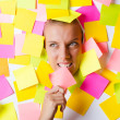 Woman with lots of reminder notes — Stock Photo #13169411