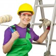 Stock Photo: Womworker with ladder on white