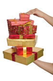 Hand holding stack of giftboxes — Stock Photo