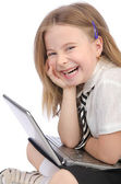 Cute girl with laptop on white — Stock Photo