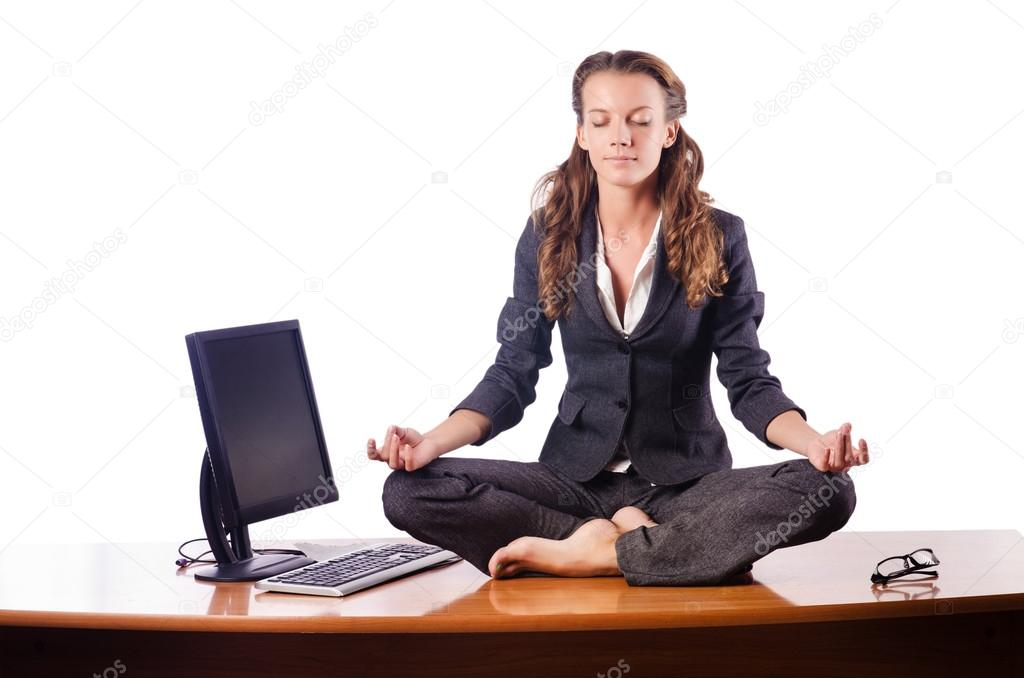 Woman meditating on the desk  Stock Photo #13169423
