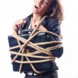 Royalty-Free Stock Photo: Businesswoman tied with rope on white