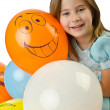 Little girl with balloons on white - Stock Photo
