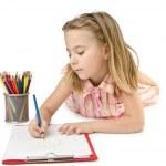 Little girl writing on white — Stock Photo