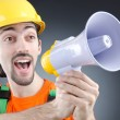 Construction worker with loudspeaker in studio — Stock Photo #13295952