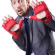 Funny businessman with boxing gloves — Stock Photo #13296374