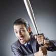 Angry businessman with bat on white — Stock Photo #13296474