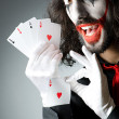 Joker with cards in studio shoot — Stock Photo #13296483