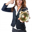 Businesswoman with alarm clock on white — Stock Photo