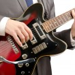 Guitar player in business suit on white - Stock Photo