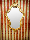 Ornate mirror on the wall — Стоковое фото