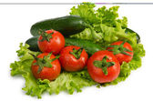 Cucumbers and tomatoes ready for salad — Stock Photo