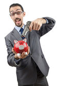 Businessman killing the piggy bank — Stock Photo