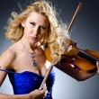 Woman with violin in studio — Stock Photo #13400628