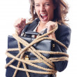 Businesswoman tied with rope on white — Stock Photo