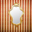 Stock Photo: Ornate mirror on the wall