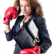 Angry businesswoman with boxing gloves — Stock Photo #13402395