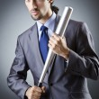 Angry businessman with bat on white — Stock Photo #13404231