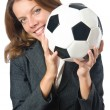 Businesswoman with football on white — Stock Photo