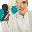 Royalty-Free Stock Photo: Female chemist in studio on white