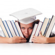 Stock Photo: Happy graduate with lots of books on white
