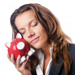 Woman with piggybank on white — Stock Photo
