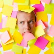 Woman with lots of reminder notes — Stock Photo #13406314