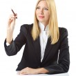 Businesswoman sitting at the desk — Stock Photo #13406487