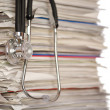 Stack of papers with stethoscope — Stock Photo