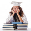 Happy graduate with lots of books on white — Stock Photo #13633135