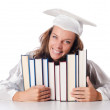Happy graduate with lots of books on white — Stock Photo