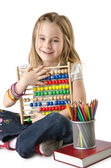 Girl with books and abacus — Stock Photo