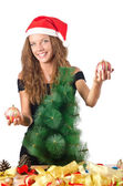 Young woman with christmas tree — Stock Photo