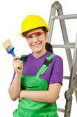 Woman worker with ladder on white — Stock Photo