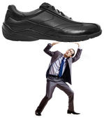 Woman domination concept with shoes and man — Stock Photo