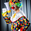 Clown in studio with loudspeaker — Foto Stock