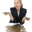 Woman with lots of coins on white — Stock fotografie