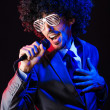 Young singer in afro wig singing at disco — Stock Photo #13872831