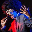 Young singer in afro wig singing at disco — Stock Photo #13872834