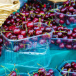 Fresh cherries on the marker - Stock Photo