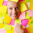 Woman with lots of reminder notes — Stock Photo