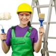 Woman worker with ladder on white — Foto Stock