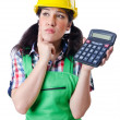 Woman builder with calculator on white - Stock Photo