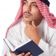 Arab man praying on white - Stock Photo