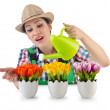 Girl watering plants on white — Foto Stock