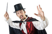 Magician doing tricks on white — Stock Photo