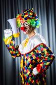 Clown in studio with loudspeaker — Stock Photo