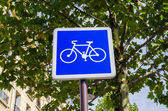 Bicycle sign on blue background — Stock Photo